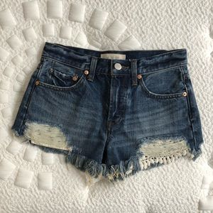 Free people denim Jean shorts with a lace detail.
